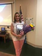 Avoyellean of the Year honoree Allison Ravarre-Augustine shortly after the presentation., with plaque and flowers form her husband in hand.